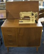Singer Table Sewing Machine Finished In Teak With Three Drawers, Together With Accessories.