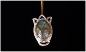 Labradorite Pendant With Chain, the labradorite cabochon, of 12.25cts, displaying a good range of