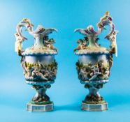 Pair Of large Continental Porcelain Urns Each vase decorated with cherubs And Satyr Moulded Handles,