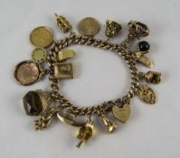 A Vintage 9ct Gold Curb Bracelet, Loaded with 18, 9ct Gold Charms +a 22ct Gold Half Sovereign.