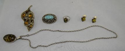A Silver and Amber Pendant Drop and Chain with Matching Ring and Earrings.