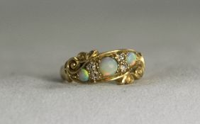 Antique 18ct Gold Opal and Diamond Set Ring. The 3 Opals Flanked by Diamonds.