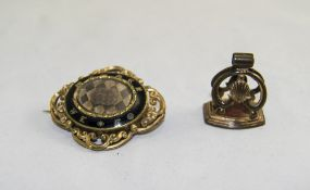 A 19th Century Gilt Metal and Enamel Mourning Brooch.