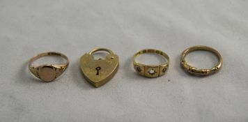 A Collection of Gold Rings and Padlock.