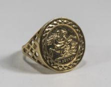 A 9ct Gold Coin Set Ring. Fully Hallmarked. Excellent Condition. 2.6 grams.