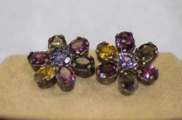 A Pair of Silver Earrings, Set with Multi - Coloured Ceylon Sapphires In The Form of Flower heads.