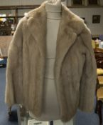 Ladies Short Blond Mink Jacket. Fully lined with hook and eye fastening and slit pockets. Some