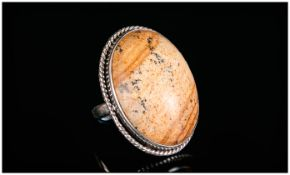 Picture Jasper Ring, a 35ct oval cut cabochon of natural picture jasper, bezel set in silver with