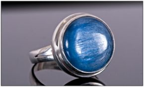 Kyanite Solitaire Hand Made Ring, a round cut, 9.3ct cabochon of the deep blue stone with the