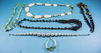 Three Various Costume Necklaces comprising an Art Nouveau style, faux moonstone, floral, pendant