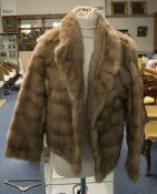 Ladies Short Blonde Mink Jacket. Fully lined with hook and eye fastening and slit pockets. approx