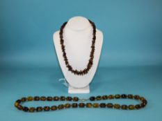 A Vintage Pair of Bead Necklaces. Lengths 35 and 22 Inches.