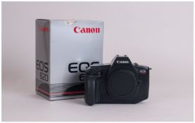 Canon EOS-620 Camera. As new condition with strap. Made 1987-1988. Complete with box and papers.