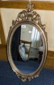 Modern Queen Anne Style Oval Wall Mirror with shell and acanthus decoration.