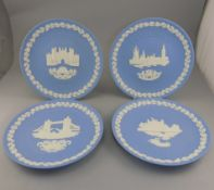 Collection of Four Wedgwood Jasper Christmas Plates comprising 1974 1975 1976 1977.