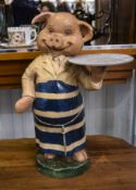 Butchers Pig Statue showing a pig in a blue striped apron holding a tray. 18 inches in height.