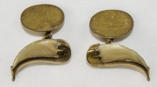 A Good Pair of Unusual 9ct Gold and Bone Cufflinks In The Form of Horns. Marked 9ct. 6 grams.
