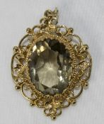 A Vintage Ornate and Open Worked 9ct Gold Pendant with a Large Faceted Pale Topaz of Over 20 cts
