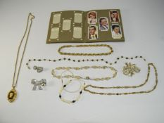 A Good Collection Of Costume Jewellery. Comprising Necklaces, Brooches, Pendants and Chains. Plus