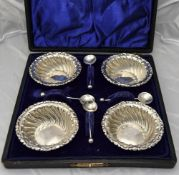 Victorian - A Fine Boxed Set of 4 Silver Salts and Spoons with Ribbed Bodies and Frilled Borders.