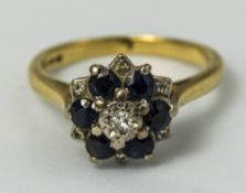 18ct Gold Dress Ring, Flowerhead Setting With 6 Sapphires And Diamond Chips,