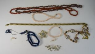 A Collection Of Costume Jewellery. Includes Coral Necklaces and Heavy Gold Plated Necklace.