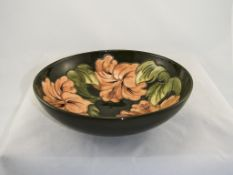W. Moorcroft Large Footed Bowl ' Coral Hibiscus ' Pattern on Green Ground. c.1970's/1980's. 3.25