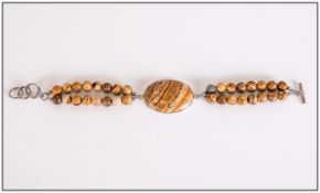 Picture Jasper Bracelet, a large oval cut, bezel set cabochon of picture jasper attached to a double