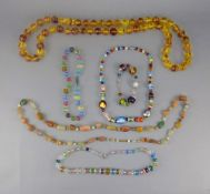 Three Various Multicolour Glass Necklaces and a Murano Glass Bracelet, a long strand of tumbled