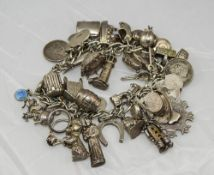 Silver Charm Bracelet, Loaded With 35+ Charms To Include The Beatles Fab 4, Top Hat, Lighthouse,