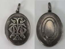 Antique Oval Shaped Silver Hinged Locket with Applied Decoration to Front Cover, Not Marked but