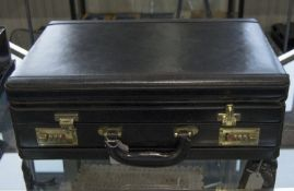 A Modern Black Leather Attache Case with Fitted Stationary Interior and Combination Locks.