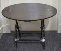 A Mahogany Campaign Table by Thornton &