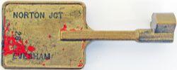 Single Line Bronze key Token stamped both sides NORTON JCT - EVESHAM 28, traces of original red