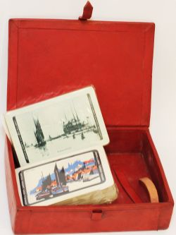 LNER Playing Cards housed in a leather covered box. There are two, unopened packs inside, one having