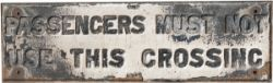 GNR cast iron sign PASSENGERS MUST NOT USE THIS CROSSING. In original condition, measures 47in x