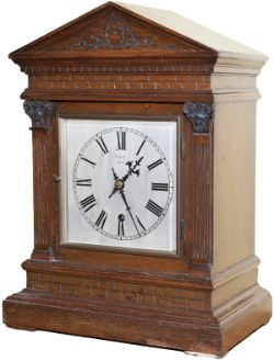 North Eastern Railway 6 inch Gothic Style Oak cased silvered dial railway clock in a bracket style