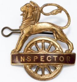 BR(W) gilt lion over wheel cap badge INSPECTOR. In very good condition complete with original back