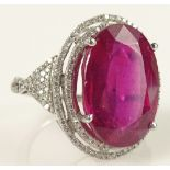 Lady's 18.41 Karat Oval Brilliant Cut Ruby and 14 Karat White Gold Ring accented with small Round