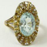 Antique Oval Cut Aquamarine, Rose Cut Diamond and 14 Karat Yellow Gold Ring. Aquamarine with nice
