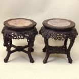 Antique Chinese Carved Hardwood Marble Top Pedestal Tables. Unsigned. Good condition. Measures 19-