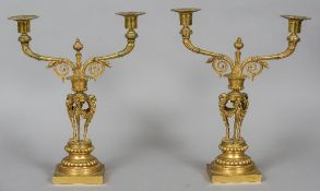 A pair of 19th century ormolu twin branch candelabra Each branch with scrolling decoration,