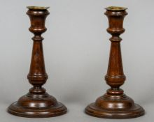 A pair of early 20th century turned oak candlesticks One with label inscribed These candlesticks