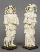 A large pair of 18th/19th century Dieppe carved ivory figures One modelled as a gentleman with a