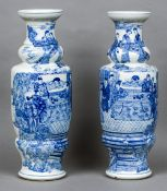 A large pair of 19th century Chinese blue and white vases Each decorated in the round with courtly