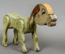 An early 20th century wooden toy dog With painted decoration, the head with leather attachments.