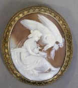 A 19th century unmarked gold framed cameo brooch Carved with a classical scene of Hebe feeding the