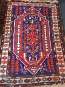 A Caucasian wool rug The sky blue field enclosing a central pole medallion within geometric guard