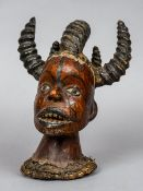 A Nigerian Ekoi tribal bust The leather covered head issuing carved spiral horns.  15 cm high.