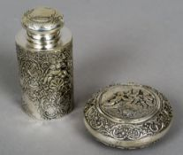 A Continental silver cylindrical tea caddy Embossed with cherubs,